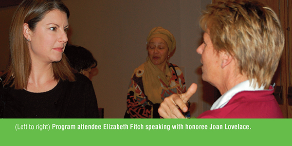 Program attendees Elizabeth Fitch speaking with honoree Joan Lovelace