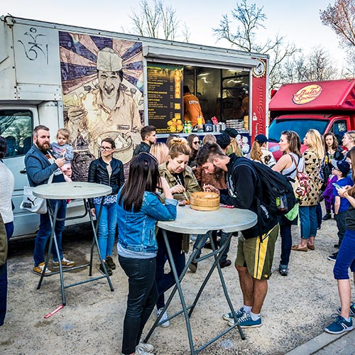Warsaw, Poland - April 1, 2017: People in front of food truck with Asian dumplings during food festival in Warsaw
