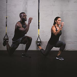 man and lady doing a lunge